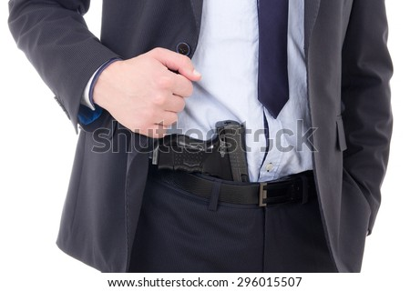 gun in policeman or bodyguard pants isolated on white background - stock photo