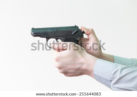 gun in the man's hand - stock photo