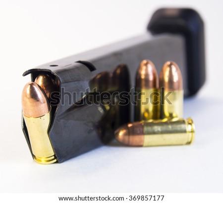 Gun magazine with 9mm rounds. Close up. - stock photo