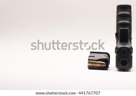 gun 9 mm. with magazine - stock photo