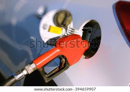 Gun petrol in the tank to fill - stock photo