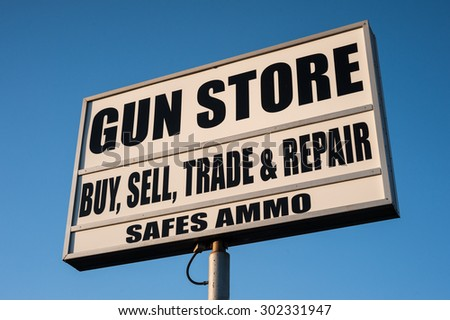 gun store sign in the United States - stock photo