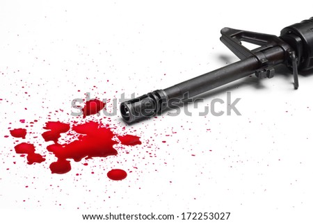 gun violence / a rifle with blood drops - stock photo