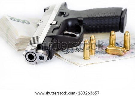 gun with bullet and czech banknotes isolated on white background - stock photo