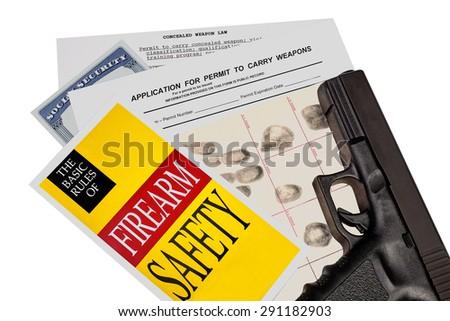 Gun with Firearm Application and CCW Permit Fingerprint ID - stock photo