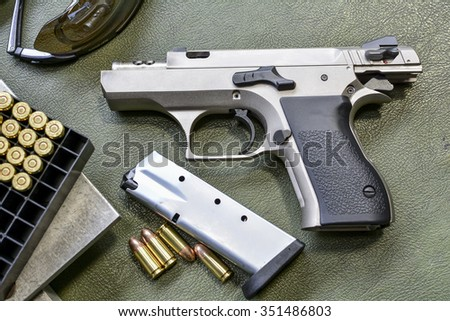 gun with rounds - stock photo