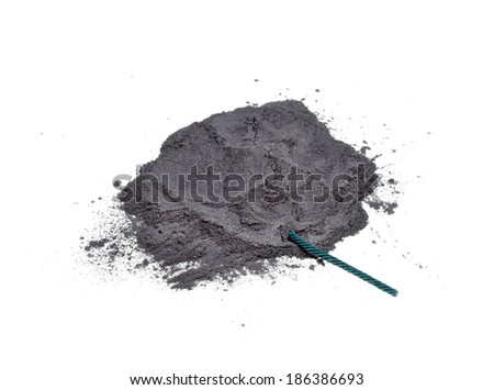 Gunpowder and green fuse on a white background - stock photo