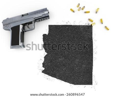 Gunpowder forming the shape of Arizona and a handgun.(series) - stock photo