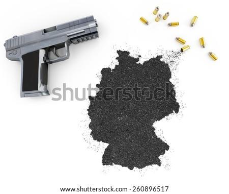 Gunpowder forming the shape of Germany and a handgun.(series) - stock photo