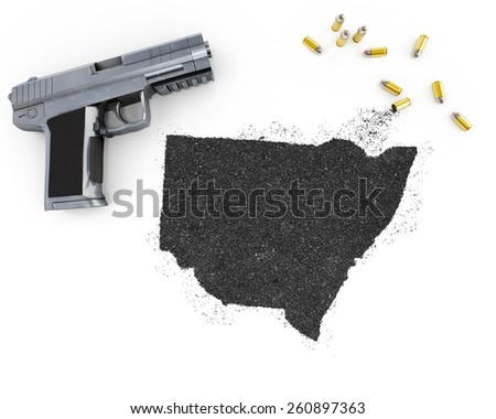 Gunpowder forming the shape of New South Wales and a handgun.(series) - stock photo