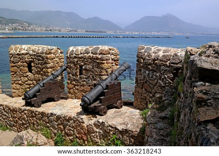 Guns of the wall of the fortress of Alanya, firing at enemy ships - stock photo