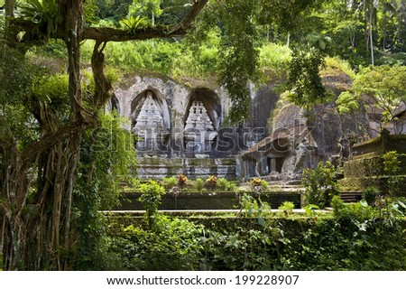 Gunung Kawi Temple. Gunug Kawi is an ancient temple situated in Pakerisan River, near Tampaksiring village in Bali. The archaeological complex is carved out of the living rock, dating to 11th century. - stock photo
