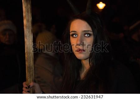 GUSSWERK, AUSTRIA - NOVEMBER 30, 2013 - Traditional Devil run (Krampuslauf) during the Christmas time. Evil girl dressed like devil. - stock photo