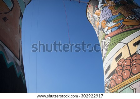 Guy bungee jumping from the Orlando Towers in Soweto, a township of Johannesburg in South Africa.   - stock photo
