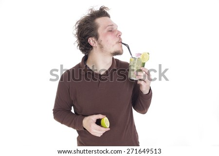 Guy drinking cocktail - stock photo