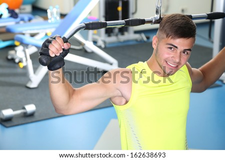 Guy engaged in simulator in gum - stock photo