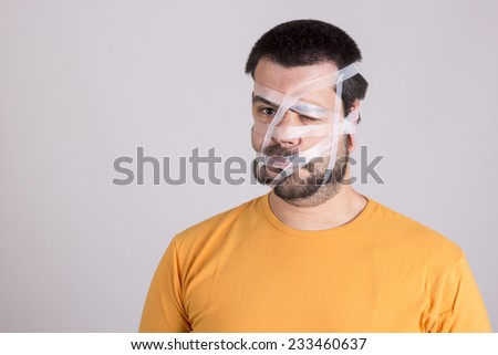 Guy funny expression with scotch tape - stock photo
