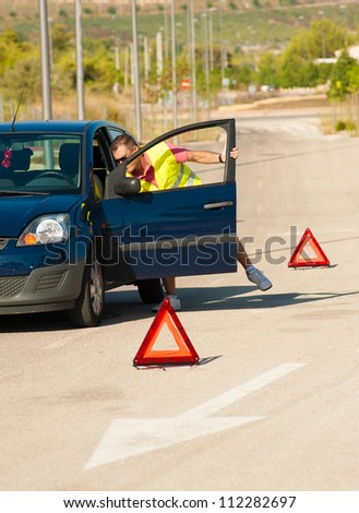 Guy having just broken down on some road - stock photo