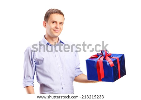 Guy holding a big present isolated on white background - stock photo