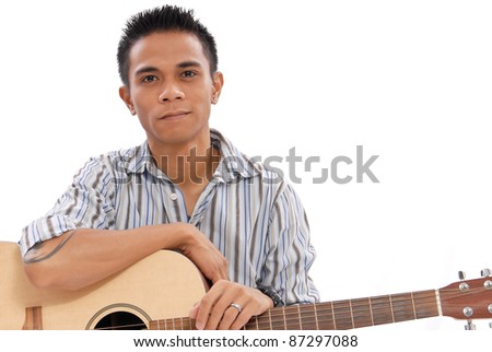 Guy Holding an Acoustic Guitar - stock photo
