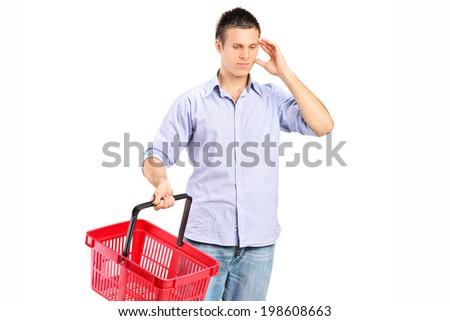 Guy holding an empty shopping basket isolated against white background - stock photo