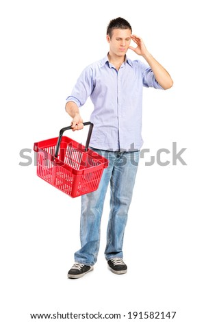 Guy holding an empty shopping basket isolated on white background - stock photo