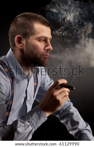 guy in a business style with a cigar - stock photo