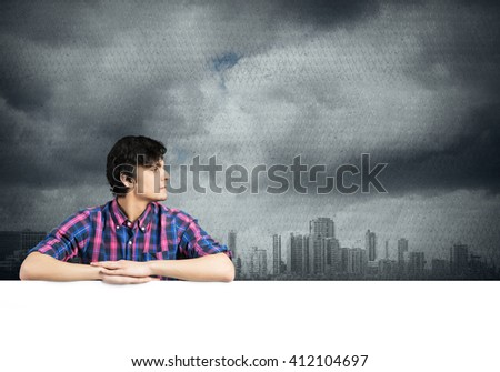 Guy in casual with placard - stock photo