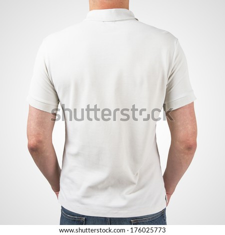 guy in white polo t-shirt standing back - stock photo