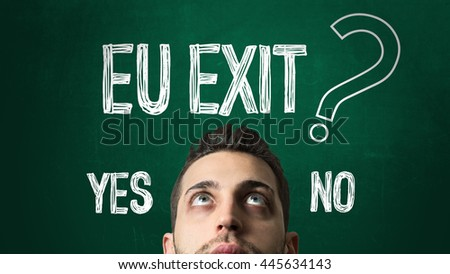 Guy Looking Up in a Chalkboard with the text: EU Exit - Yes or No? - stock photo