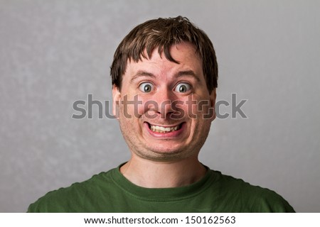 Guy making a creepy smile with a nice distorted head - stock photo