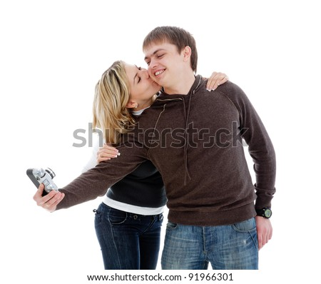 Guy photographed himself with a girl retro camera, a girl kisses a guy, isolated on a white background. - stock photo