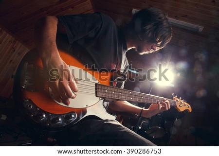 guy playing bass, guitar close-гз - stock photo