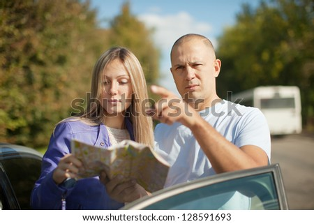 Guy points the direction at the road - stock photo