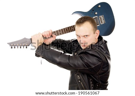 guy rock guitarist in the leather clothing isolated on white background - stock photo
