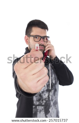 Guy showing conexion of telephone - stock photo