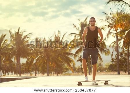 guy skateboard at sunset - stock photo