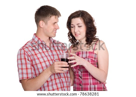 Guy treats a girl with a refreshing drink. - stock photo