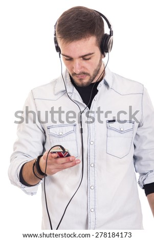 Guy using smartphone with headphones for listening to music - stock photo