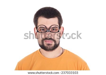 Guy wearing glasses upside down - stock photo