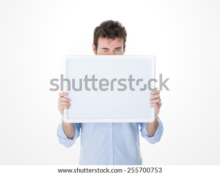 guy with one eyes closed behind a white banner - stock photo