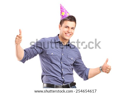 Guy with party hat giving thumbs up isolated on white background - stock photo