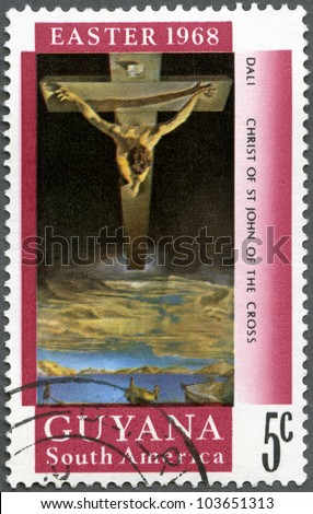 GUYANA - CIRCA 1968: A stamp printed in Guyana shows Christ of St. John of the Cross by Salvador Dali, circa 1968 - stock photo