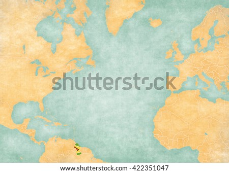 Guyana (Guyanese flag) on the map of North Atlantic Ocean. The Map is in vintage style and sunny mood. The map has soft grunge and vintage atmosphere, like watercolor painting on old paper.  - stock photo