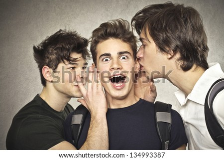 guys talk to each other in the ear - stock photo