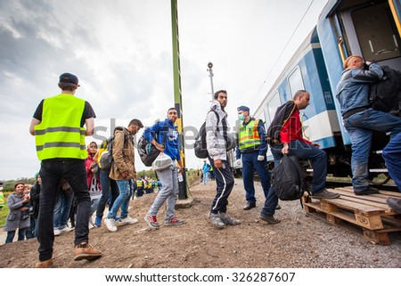 GYEKENYES- OCTOBER 6 : War refugees at the Gyekenyes Zakany Railway Station on 6 October 2015 in Gyekenyes, Hungary. Refugees are arriving constantly to Hungary on the way to Germany. - stock photo