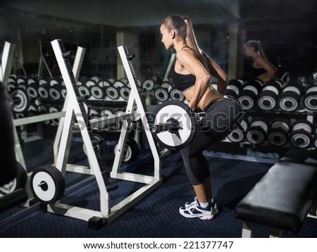 Gym.Sporty girl posing - stock photo