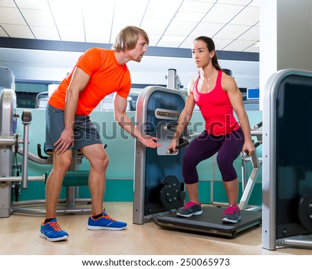 Gym squat machine exercise workout fit woman at indoor - stock photo