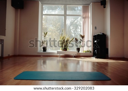 gym with yoga mat Interior - stock photo