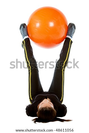 gym woman doing pilates exercises on an orange ball isolated over white - stock photo